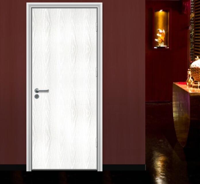 white interior wooden bedroom door