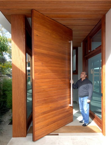 Modern wooden front pivot door for Big entrance door